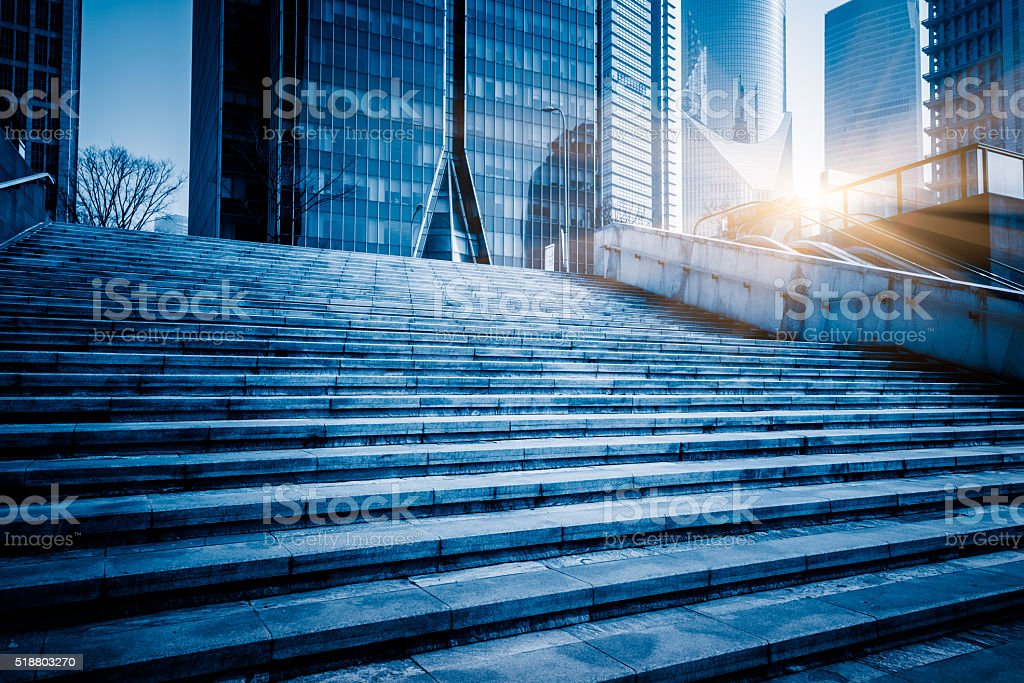 blue toned office building stock photo