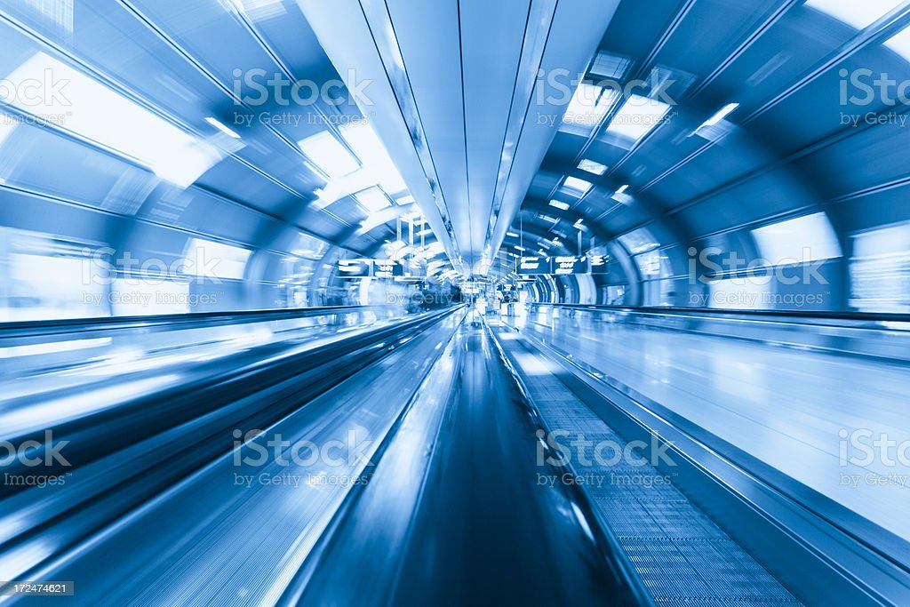 Blue toned photo of Frankfurt airport's moving walkways stock photo