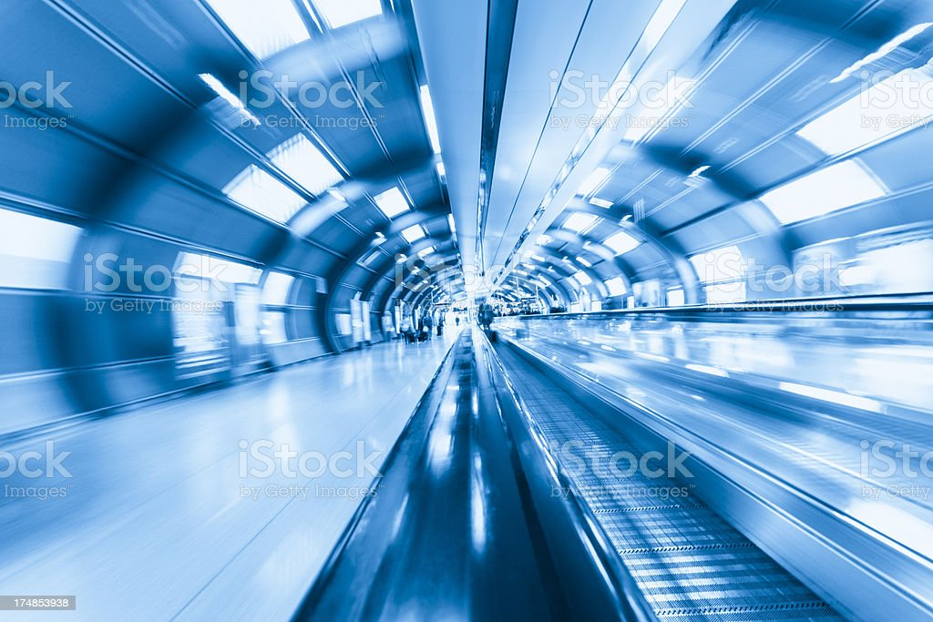 Blue toned photo of Frankfurt airport's moving walkways royalty-free stock photo