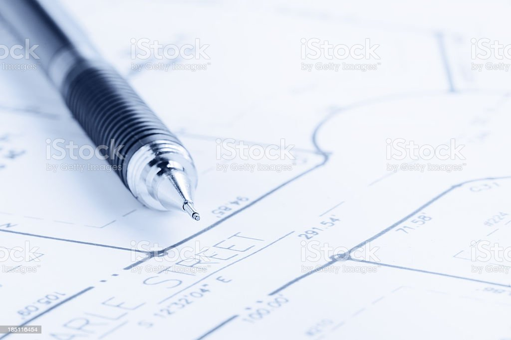 Blue Toned Residential Development Blueprint and Drafting Pencil stock photo