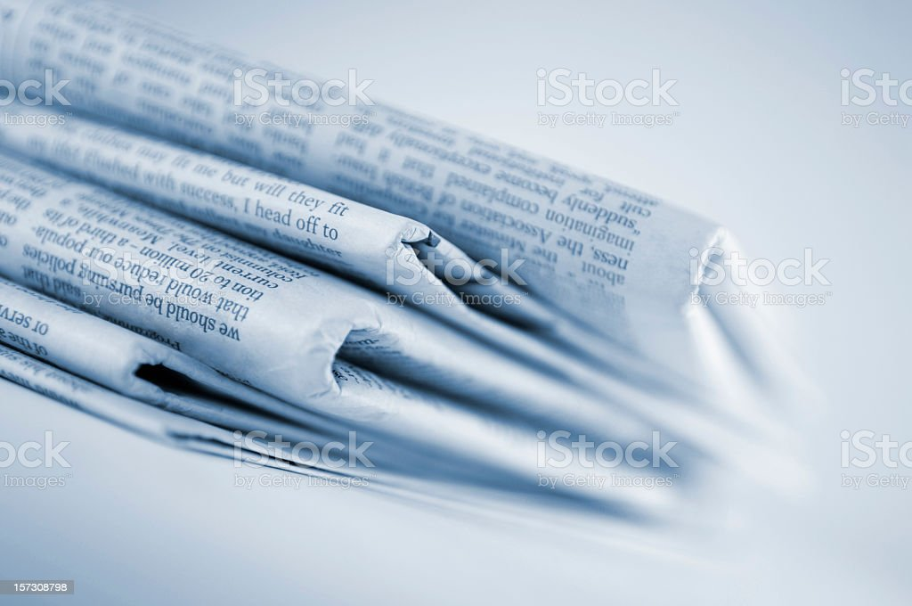 Blue Toned Stack of Newspapers stock photo