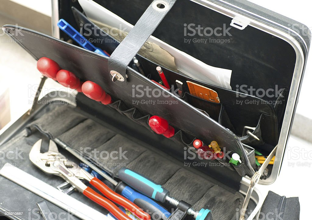 blue toolbox with boring bits - Werkzeugkiste stock photo