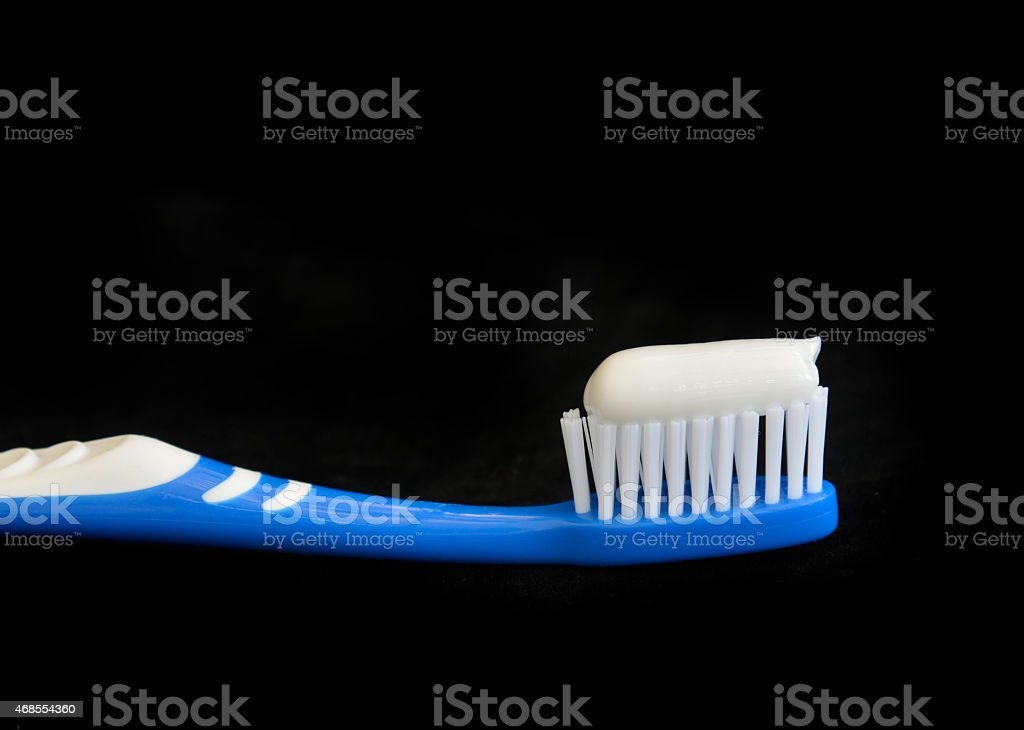 Blue toothbrush and toothpaste. stock photo