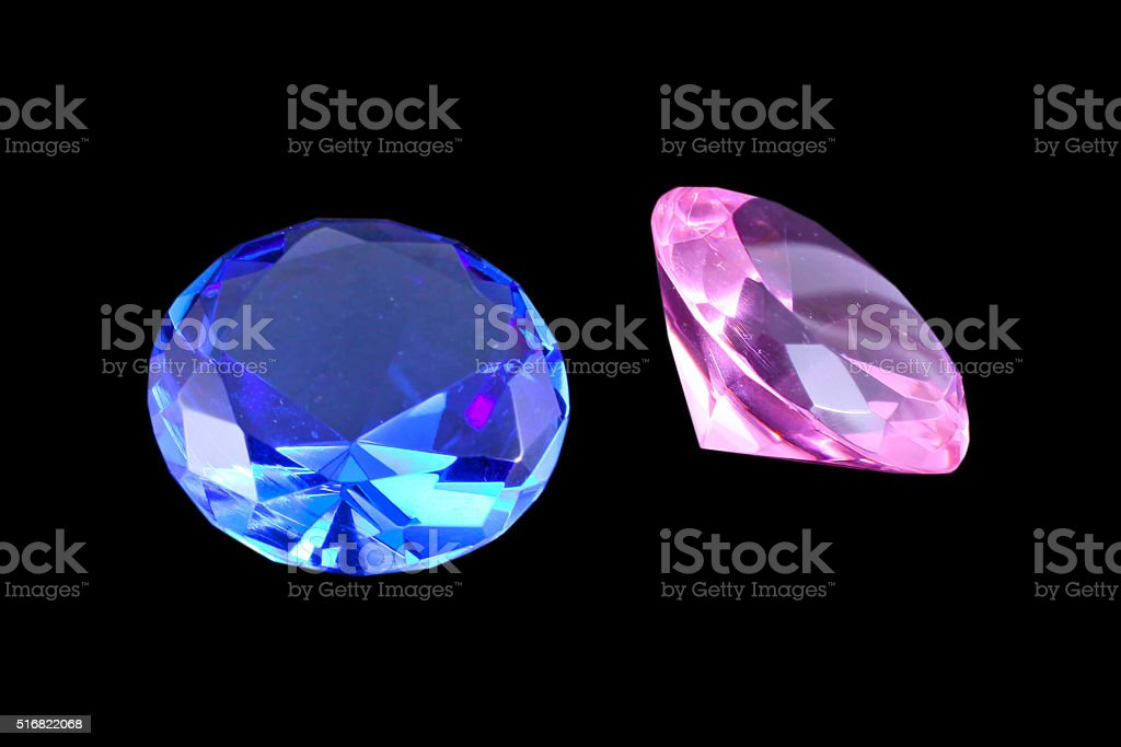 Blue topaz and pink diamond gemstones on black background stock photo