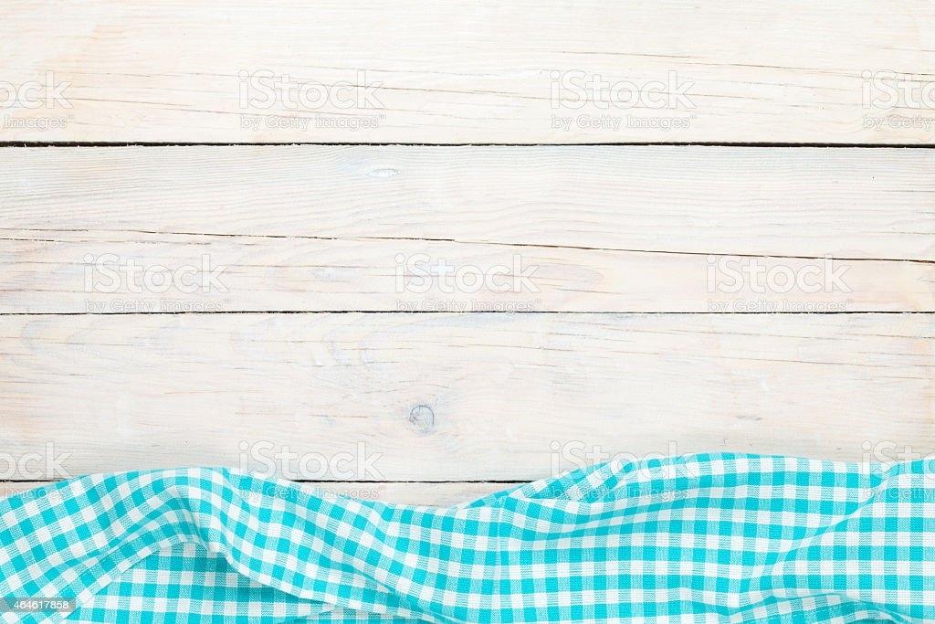 Blue towel over wooden kitchen table stock photo