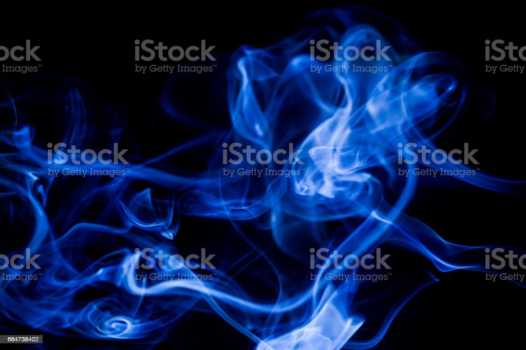 Blue toxic fumes movement on a black background. stock photo
