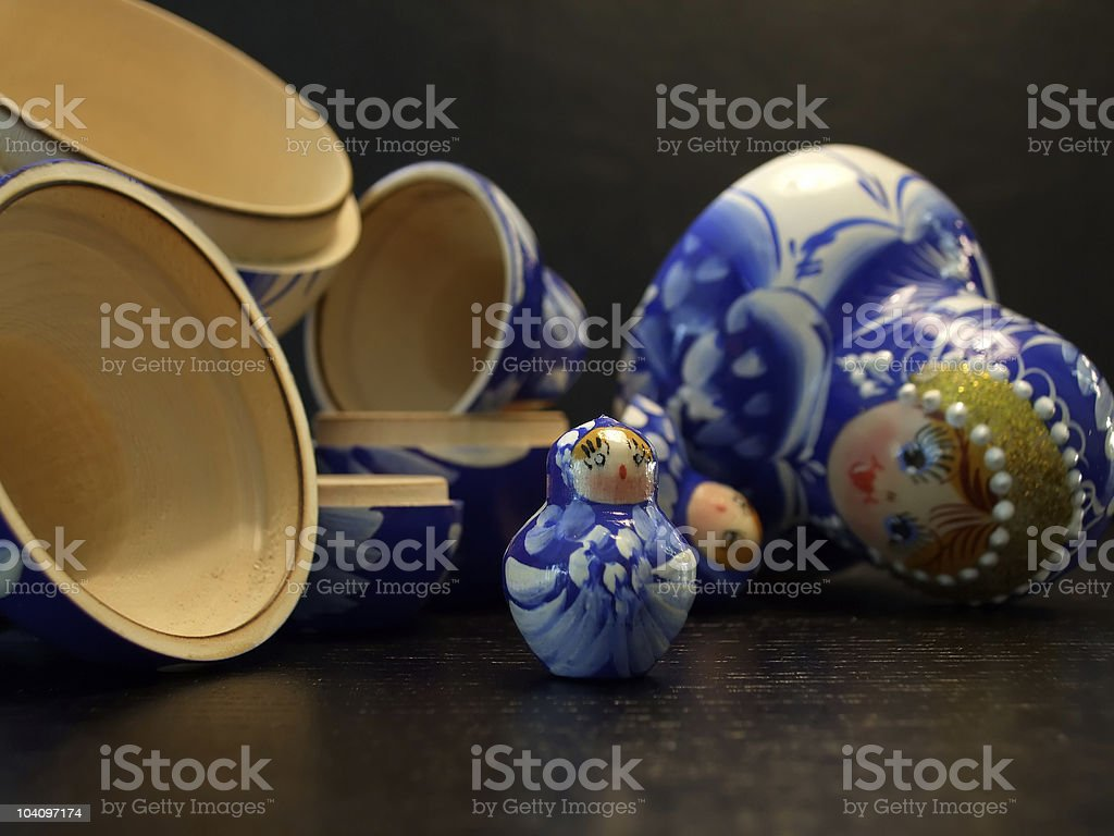 blue traditional russian dolls on black background stock photo