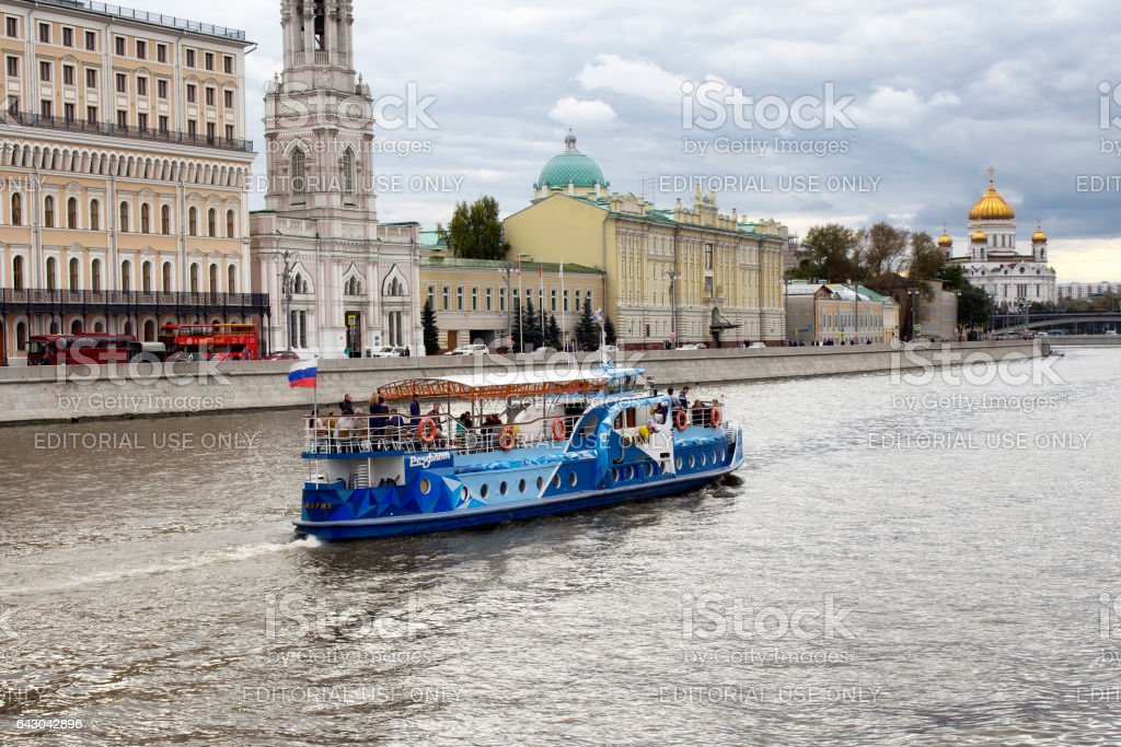 Blue, traditional tour boat on Moskva river in Moscow. stock photo