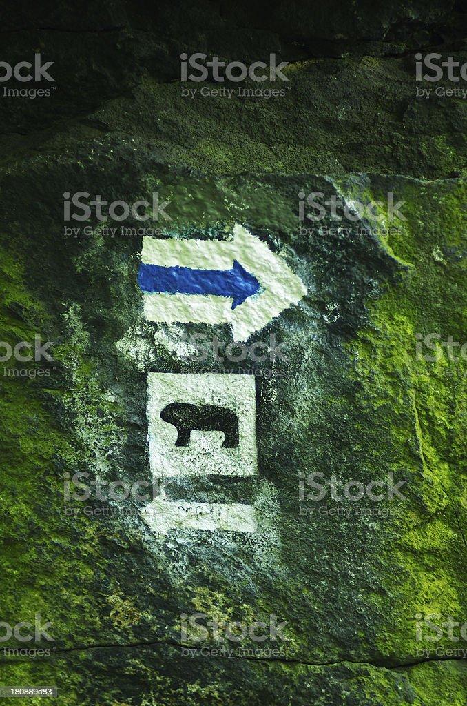 Blue trail mark with bear symbol stock photo