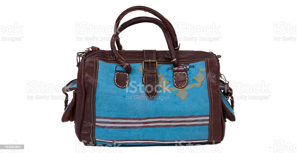 Blue travel bag on a white background royalty-free stock photo