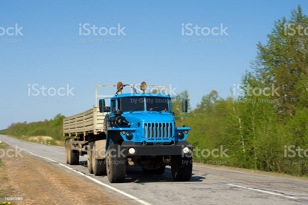 Blue truck on a road royalty-free stock photo