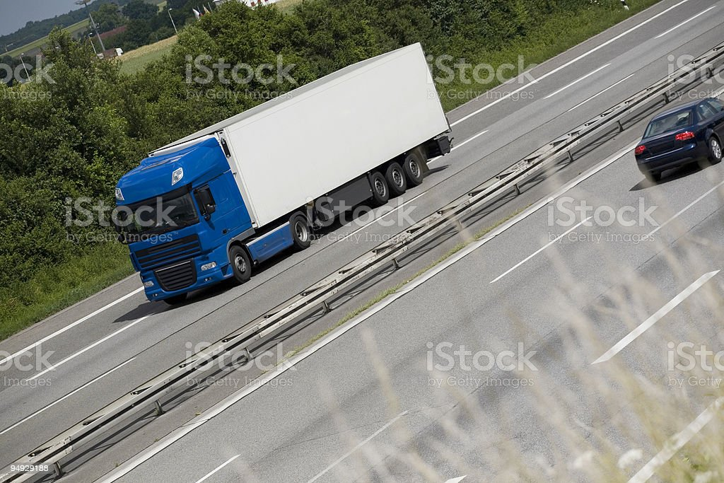 Blue truck on german highway royalty-free stock photo