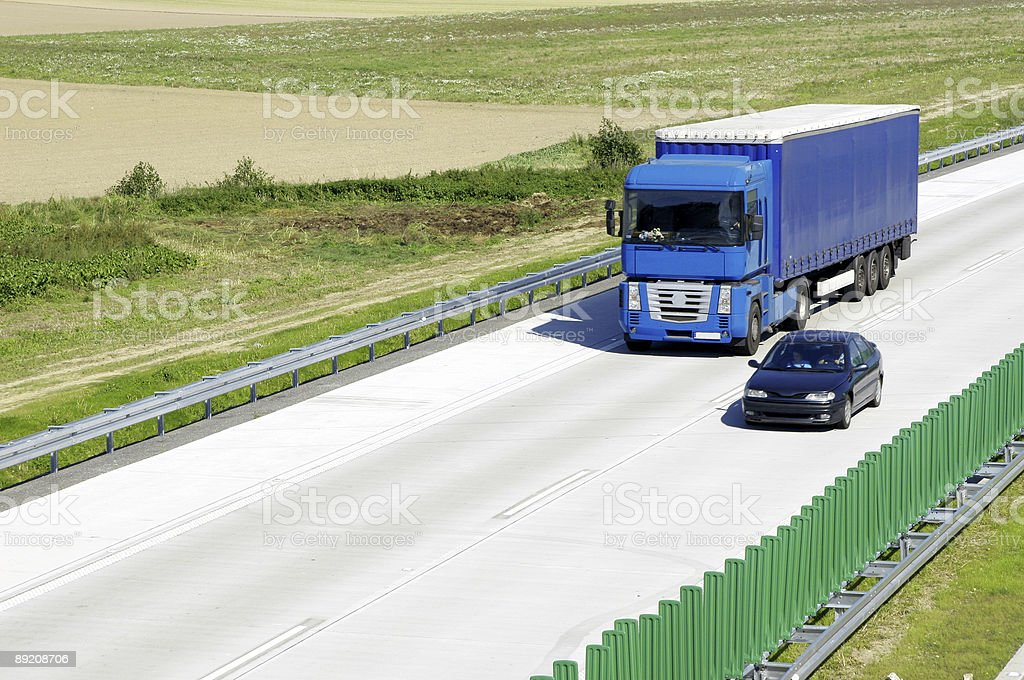 Blue truck on highway royalty-free stock photo