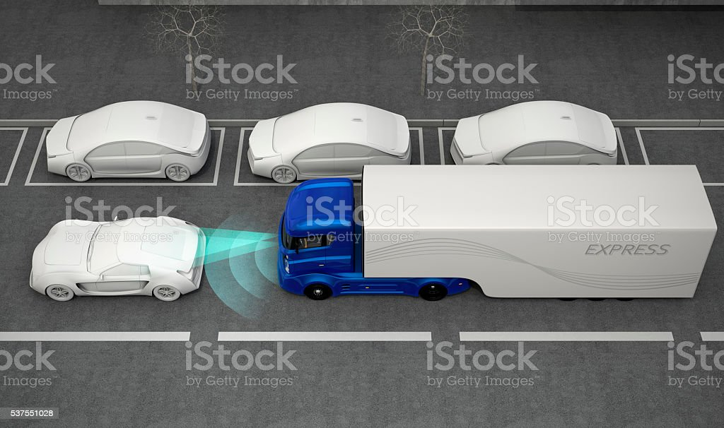 Blue truck stopped by automatic braking system stock photo