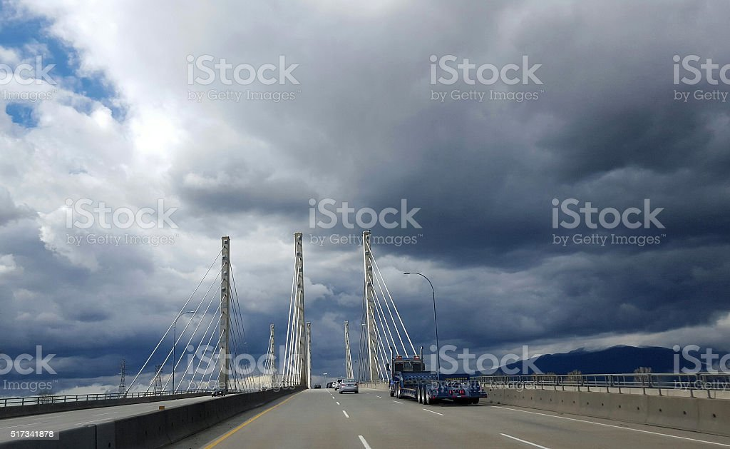 Blue Truck Traveling Cable Stayed Bridge Port Coquitlam stock photo
