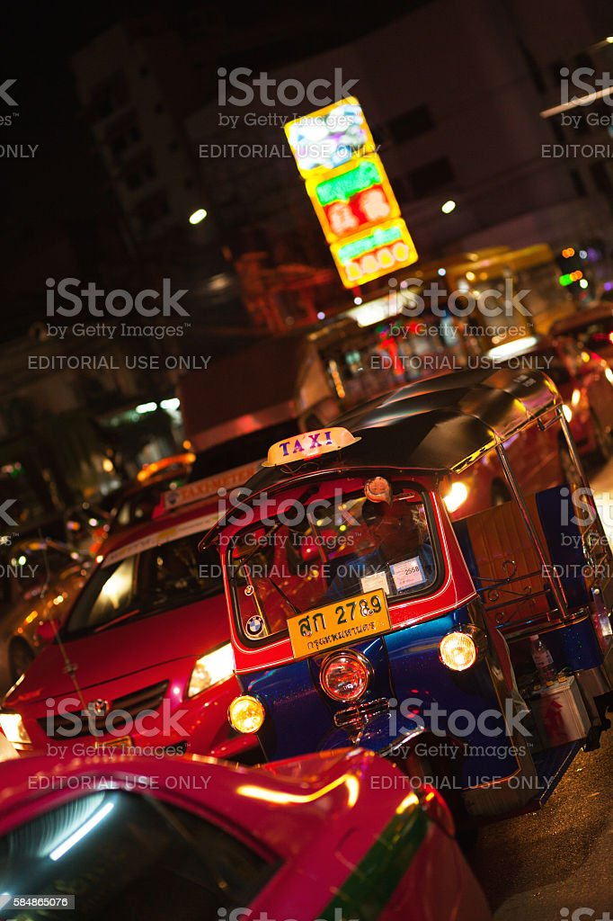 Blue tuktuk and pink taxis in Chinatown stock photo