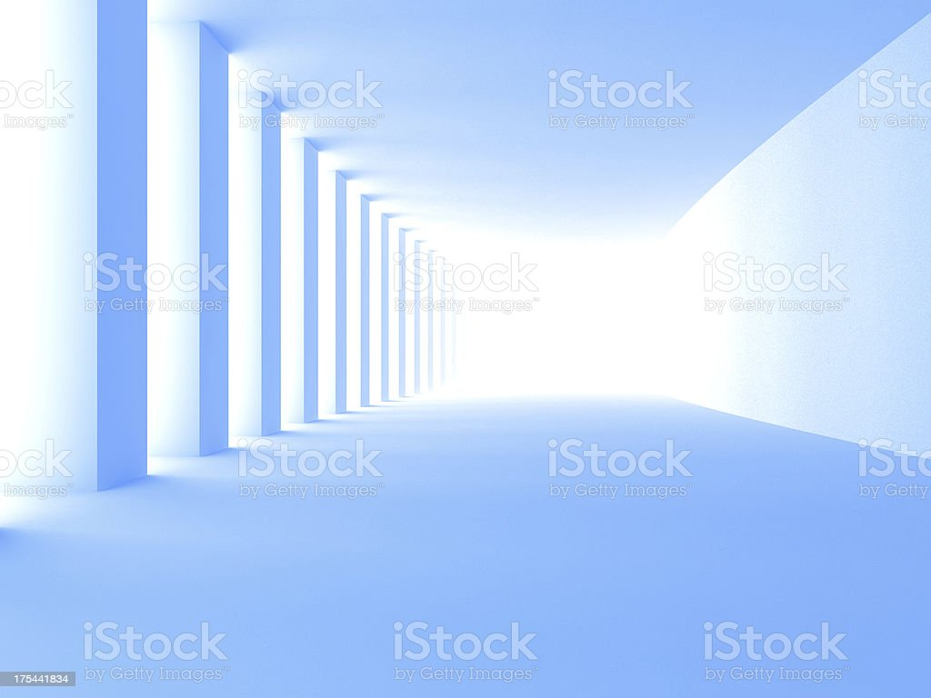 Blue tunnel with bright light at end stock photo