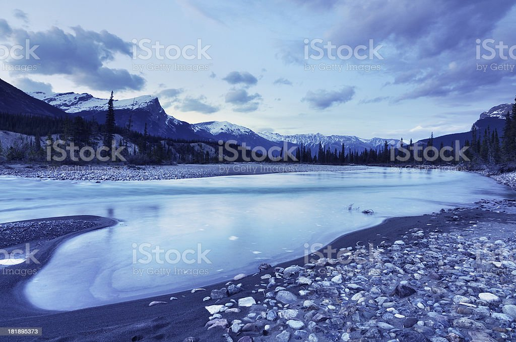 Blue twilight mountain landscape at North Saskatchewan River, Canadian Rokies stock photo