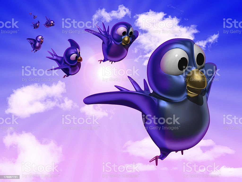 Blue twittering birds flying in the sky royalty-free stock photo