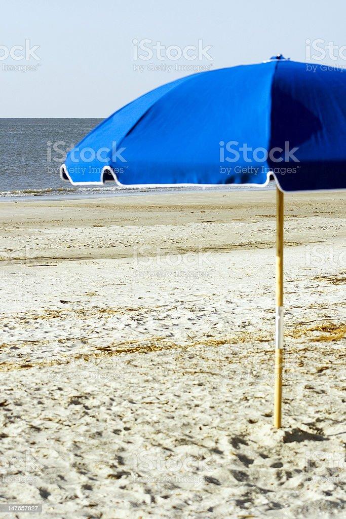 Blue Umbrella on the Beach stock photo