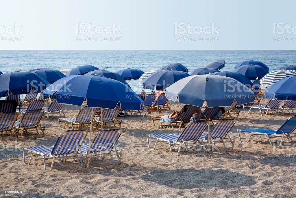 Blue umbrellas stock photo
