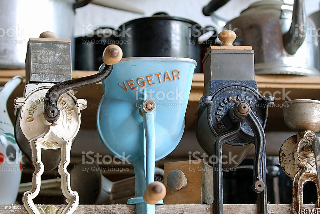 Blue vegetable grater and meat wolf in an old kitchen stock photo
