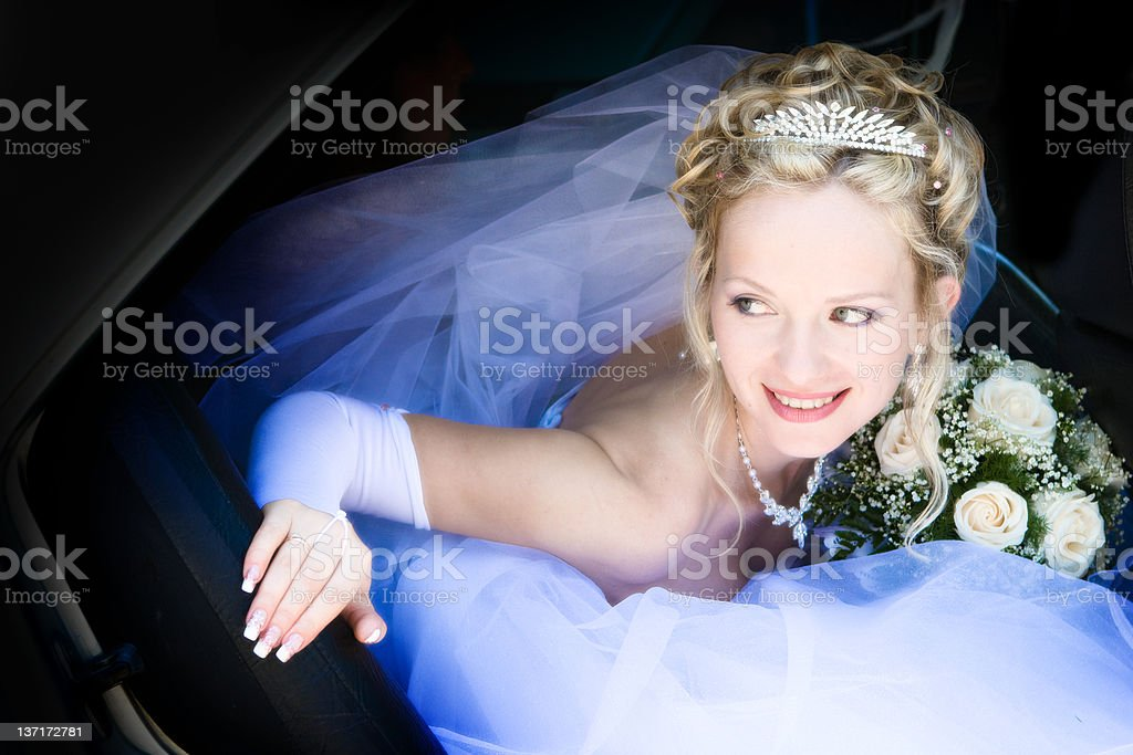 Blue veil. bride in the car. royalty-free stock photo