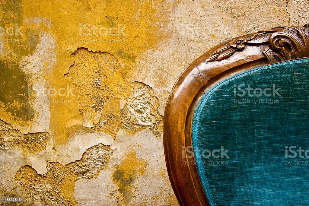 Blue Velvet Chair (Detail) Against Mottled Yellow Wall, Rome, Italy stock photo