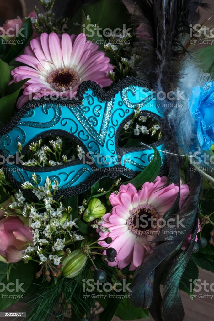 Blue venetian mask with flowers stock photo