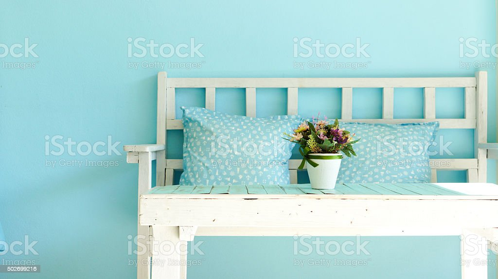 Blue vintage living room with white bench stock photo