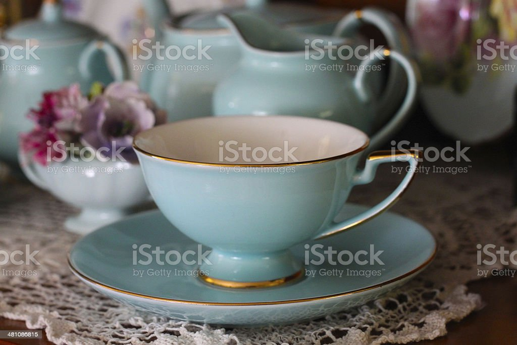 Blue Vintage Tea Cup with Floral Decorations stock photo