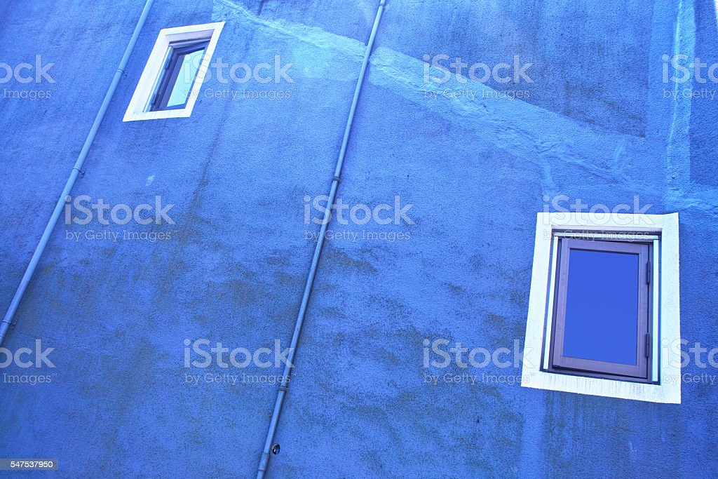 Blue wall and windows stock photo