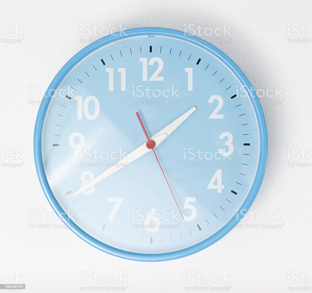 blue wall clocks on white ground stock photo