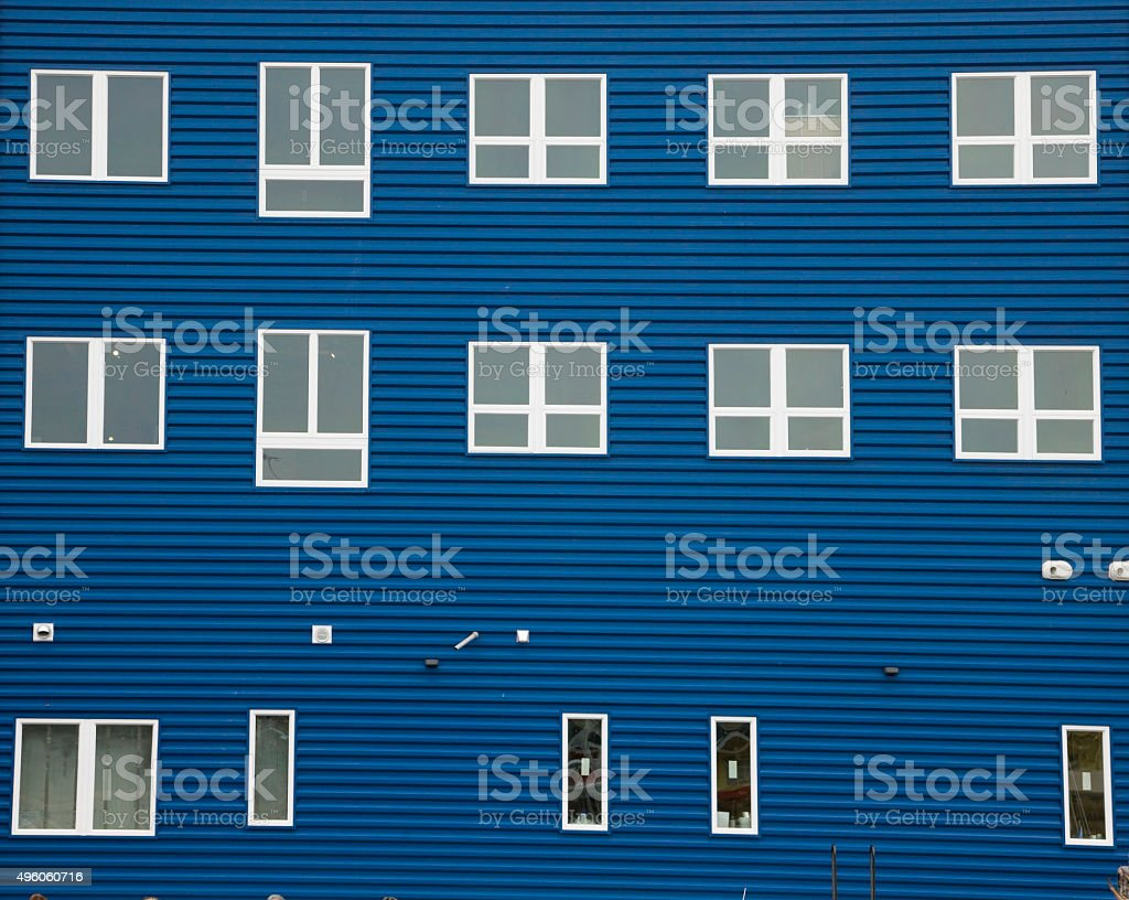 Blue wall of shipyard building in Portland, Maine stock photo