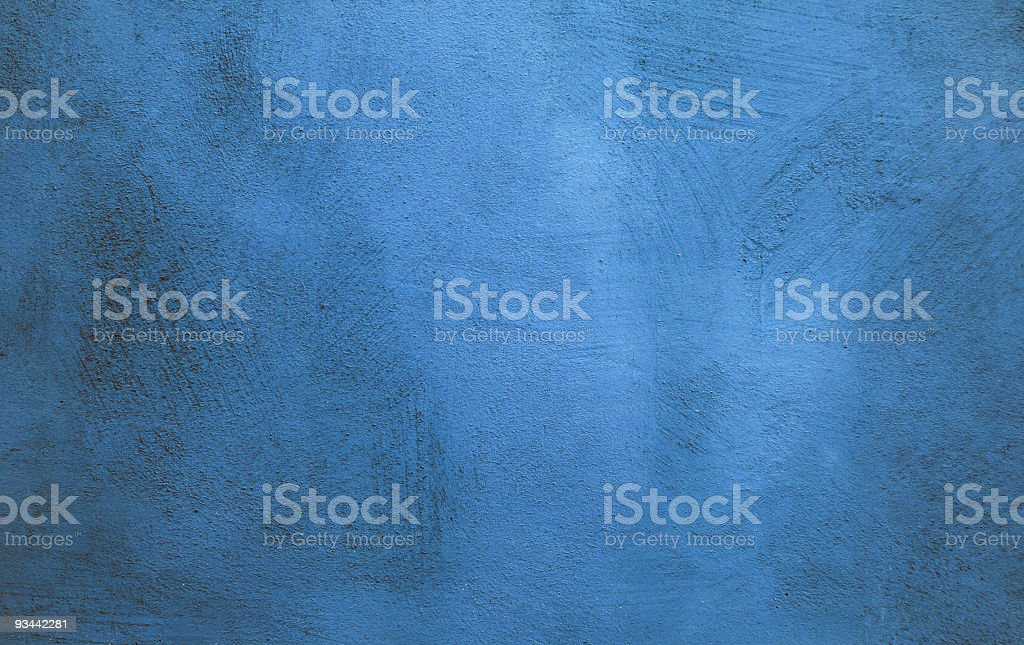 A blue wall texture with streaks across it royalty-free stock photo