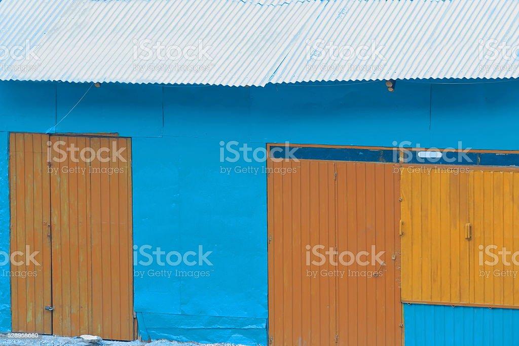 Blue wall-brownish doors-blue tin roof. Kombolcha-Ethiopia. 0504 stock photo