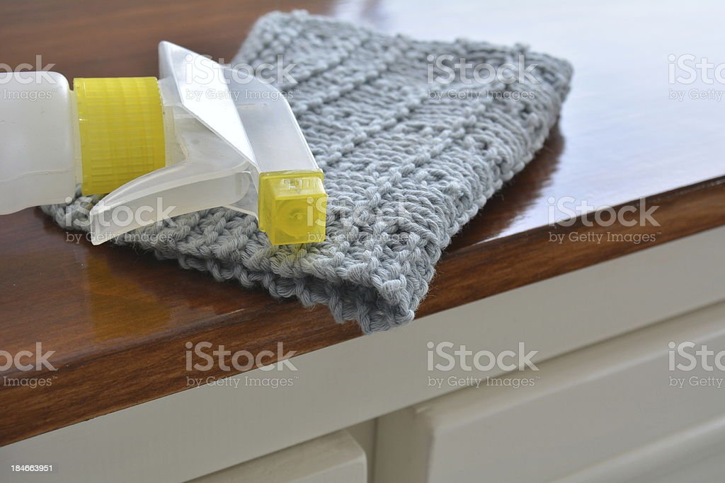 Blue wash cloth with spray cleaner royalty-free stock photo