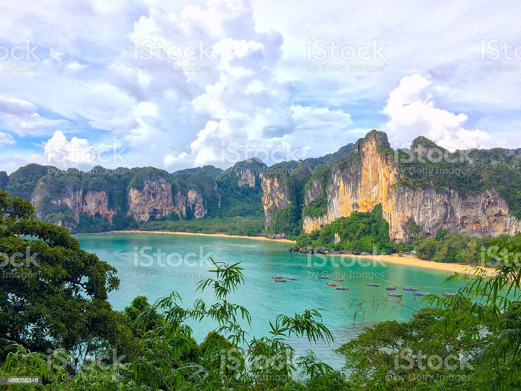 Blue water and tropical jungle, limestone cliffs in Railay. stock photo