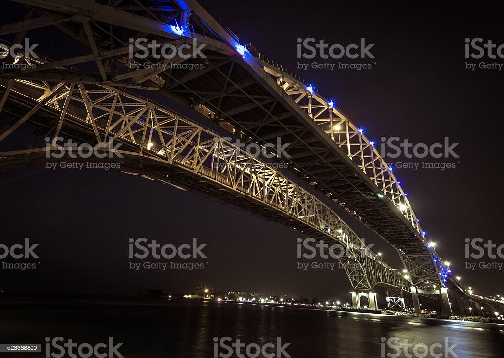 Blue Water Bridge Border Crossing At Night stock photo