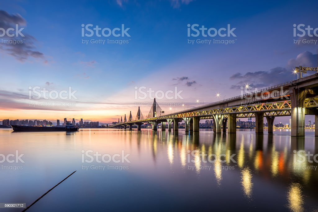 Blue Water Bridge Over   River Against Sky During Sunset stock photo