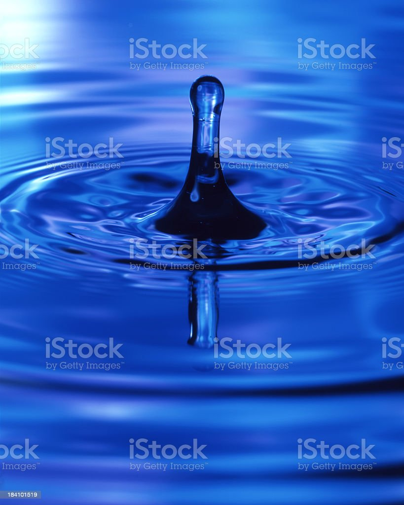 Blue water drip and ripples royalty-free stock photo