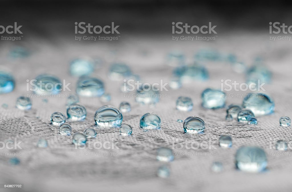 Blue water drops in macro stock photo