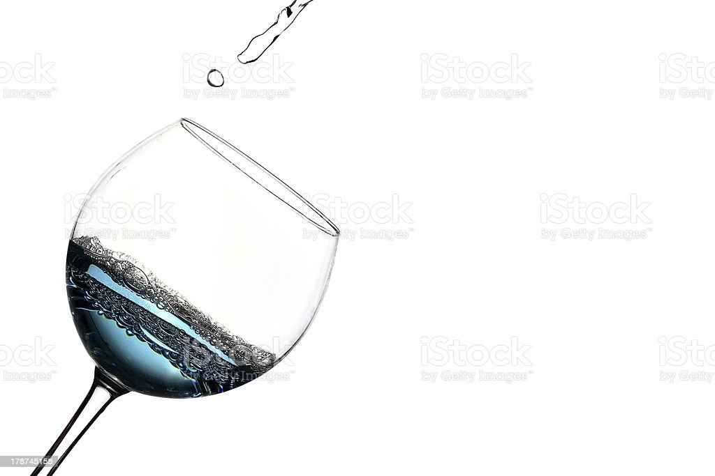 Blue water glass is poured royalty-free stock photo