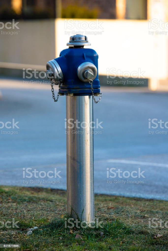 Blue water hydrant stock photo