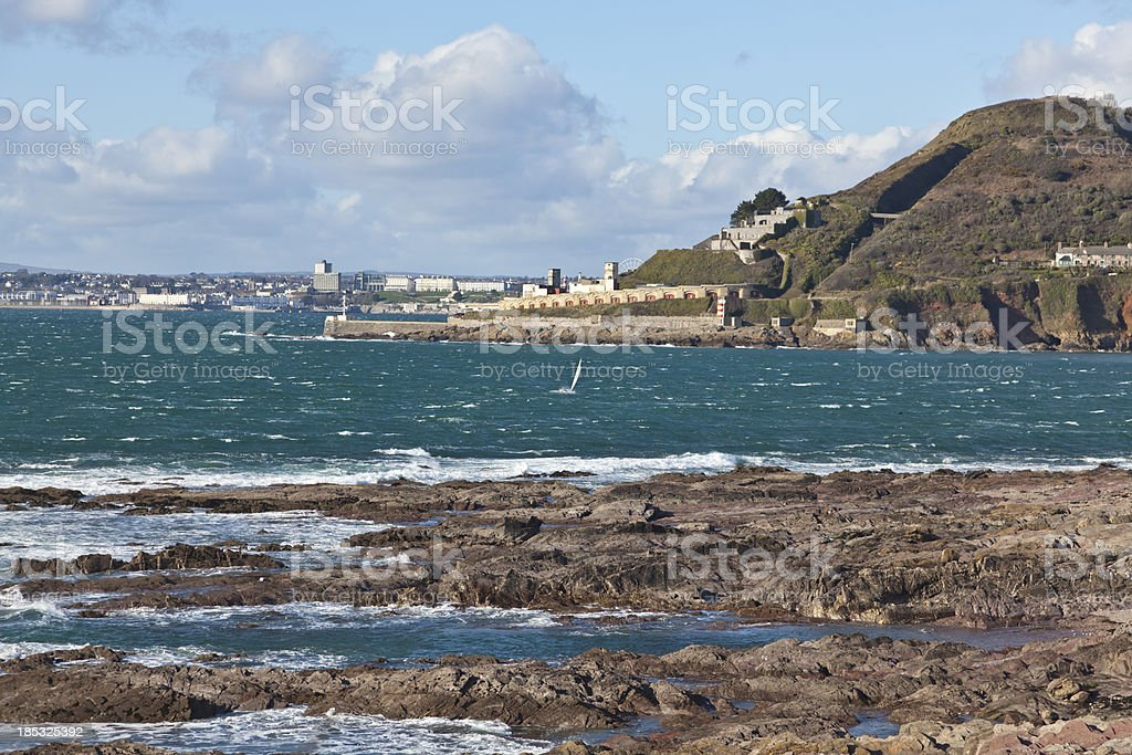 Blue water of Plymouth Sound and Fort Bovisand stock photo