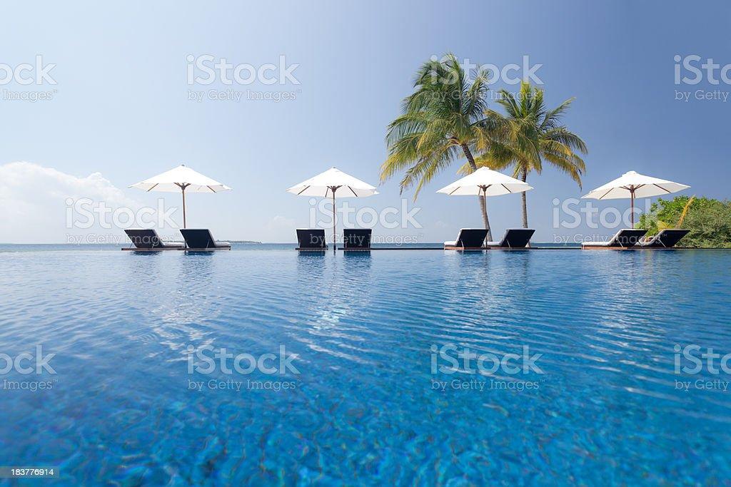 blue water of swimming pool on luxury island stock photo