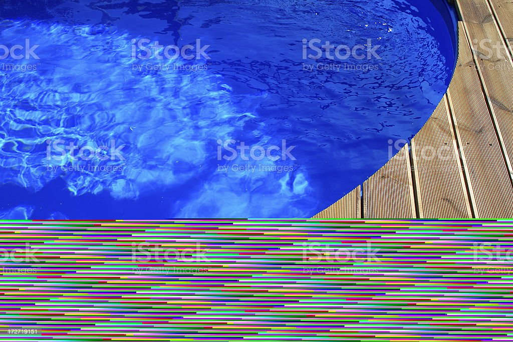 Blue water pool with wooden decking royalty-free stock photo