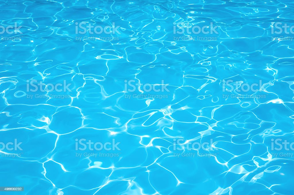 Blue water rippled background in swimming pool stock photo