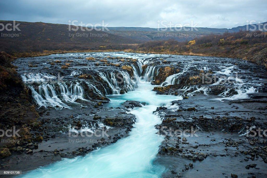 Blue Water Running On Black Bedrock stock photo