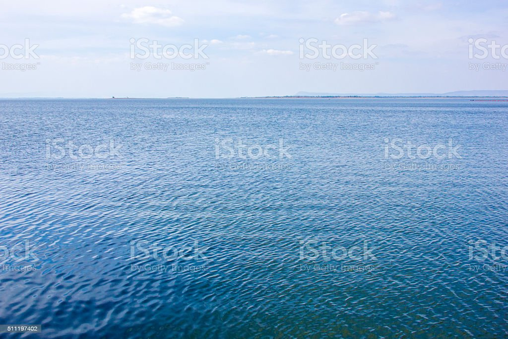 Blue water surface and blue sky stock photo